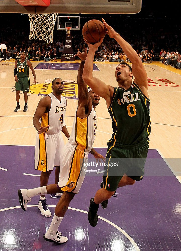 Enes Kanter #0 of the Utah Jazz shoots over Jordan Hill #27 of the Los Angeles Lakers at Staples Center on December 9, 2012 in Los Angeles, California. The Jazz won 117-110.
