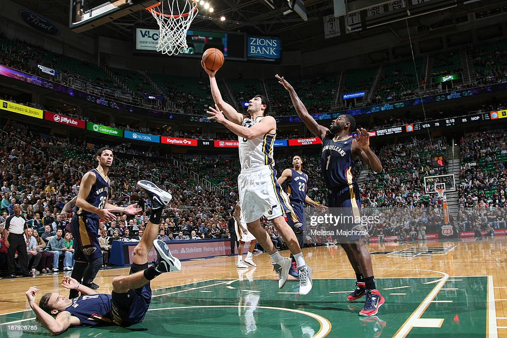 <a gi-track='captionPersonalityLinkClicked' href=/galleries/search?phrase=Enes+Kanter&family=editorial&specificpeople=5621416 ng-click='$event.stopPropagation()'>Enes Kanter</a> #0 of the Utah Jazz shoots past <a gi-track='captionPersonalityLinkClicked' href=/galleries/search?phrase=Tyreke+Evans&family=editorial&specificpeople=4851025 ng-click='$event.stopPropagation()'>Tyreke Evans</a> #1 of the New Orleans Pelicans at EnergySolutions Arena on November 13, 2013 in Salt Lake City, Utah.