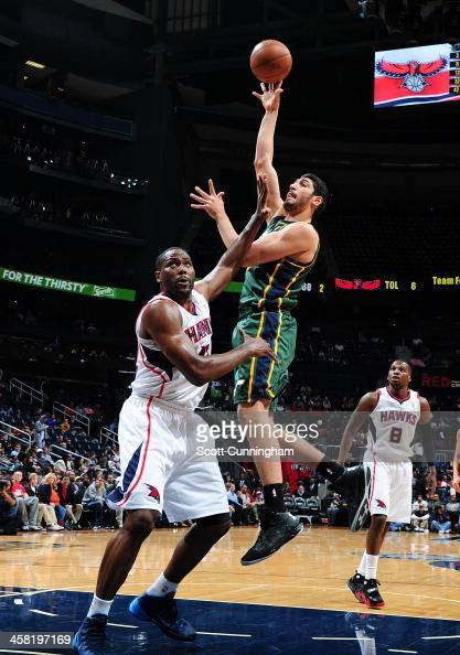 Enes Kanter of the Utah Jazz shoots the ball against the Atlanta Hawks on December 20 2013 at Philips Arena in Atlanta Georgia NOTE TO USER User...