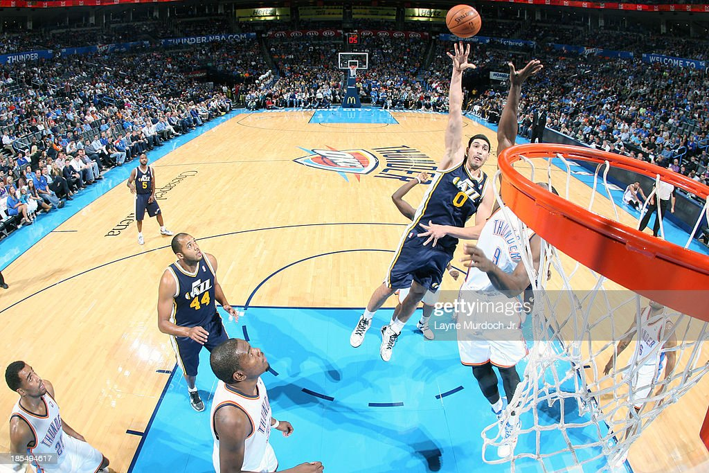 <a gi-track='captionPersonalityLinkClicked' href=/galleries/search?phrase=Enes+Kanter&family=editorial&specificpeople=5621416 ng-click='$event.stopPropagation()'>Enes Kanter</a> #0 of the Utah Jazz shoots the ball against the Oklahoma City Thunder during an NBA preseason game on October 20, 2013 at the Chesapeake Energy Arena in Oklahoma City, Oklahoma.