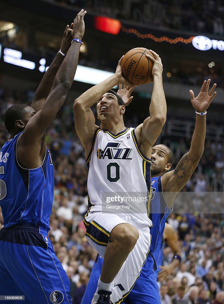 Enes Kanter #0 of the Utah Jazz shoots the ball between Bernard James #5 and Dahntay Jones #30 of the Dallas Mavericks during the second half of an NBA game October 31, 2012 at EnergySolution Arena in Salt Lake City, Utah.