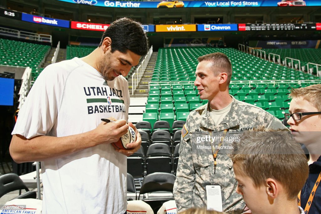 Enes Kanter #0 of the Utah Jazz signs autographs before the game against the Denver Nuggets at EnergySolutions Arena on November 11, 2013 in Salt Lake City, Utah.