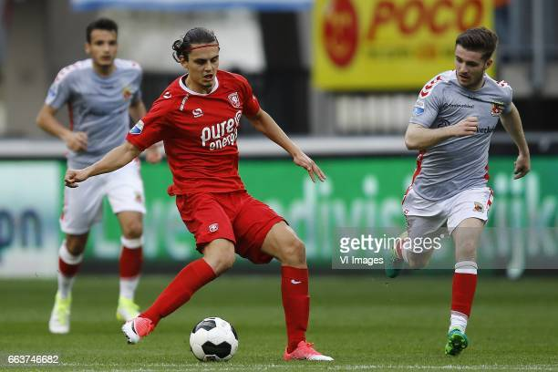 Enes Unal of FC Twente Daniel Crowley of Go Ahead Eaglesduring the Dutch Eredivisie match between FC Twente and Go Ahead Eagles at the Grolsch Veste...