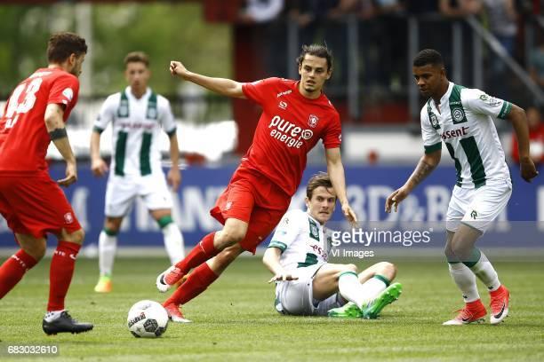 Enes Unal of FC Twente Etienne Reijnen of FC Groningen Juninho Bacuna of FC Groningenduring the Dutch Eredivisie match between FC Twente and FC...