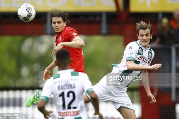 Enes Unal of FC Twente Etienne Reijnen of FC Groningenduring the Dutch Eredivisie match between FC Twente and FC Groningen at the Grolsch Veste on...