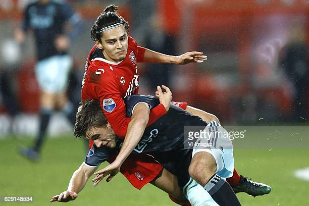 Enes Unal of FC Twente Joel Veltman of Ajax Amsterdamduring the Dutch Eredivisie match between FC Twente and Ajax Amsterdam at the Grolsch Veste on...