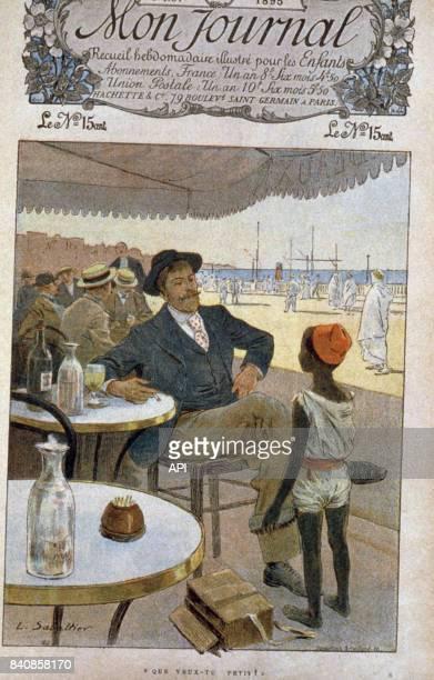 Enfant cireur de chaussures dans une colonie française