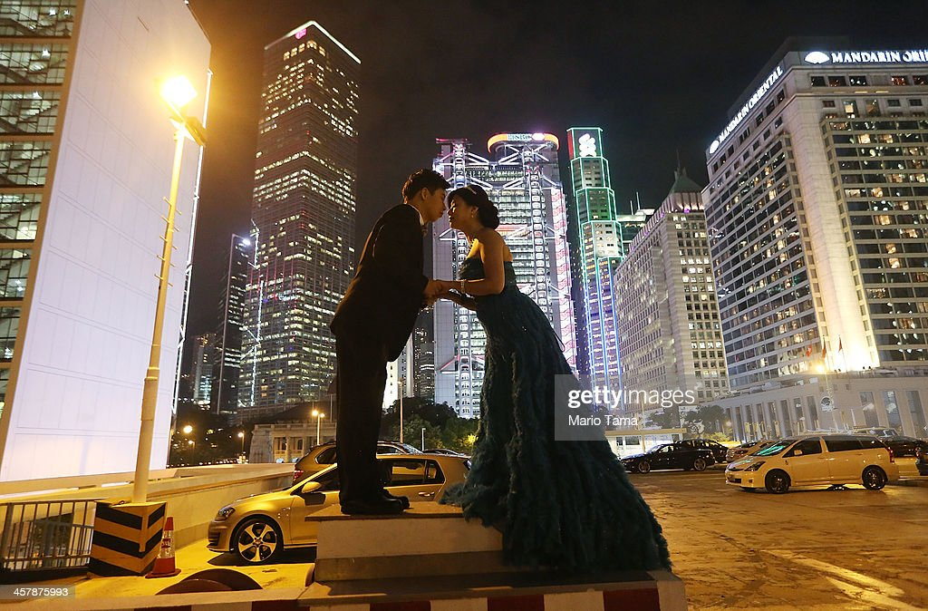 Engaged couple Tommy Ho (L) and Cindy Lai embrace while posing for their wedding photographer on December 19, 2013 in Hong Kong, China. Hong Kong leads the world in economic freedom according to the Heritage Foundation.