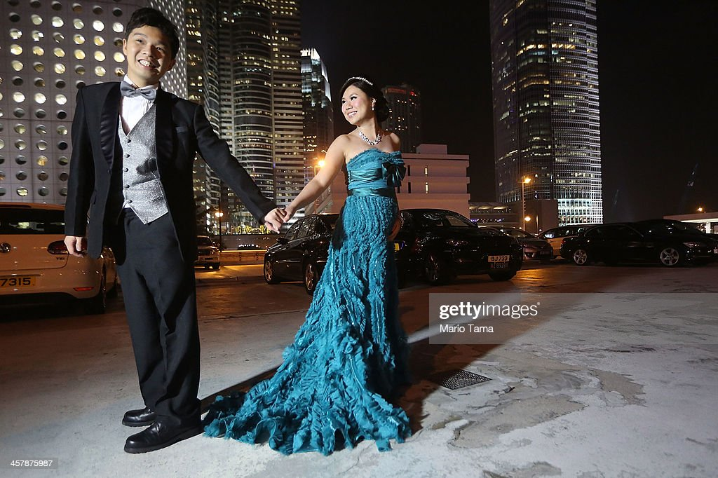 Engaged couple Tommy Ho (L) and Cindy Lai smile while posing for their wedding photographer on December 19, 2013 in Hong Kong, China. Hong Kong leads the world in economic freedom according to the Heritage Foundation.