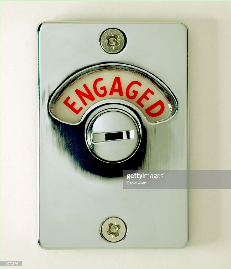 Engaged signn on a door latch : Stock Photo
