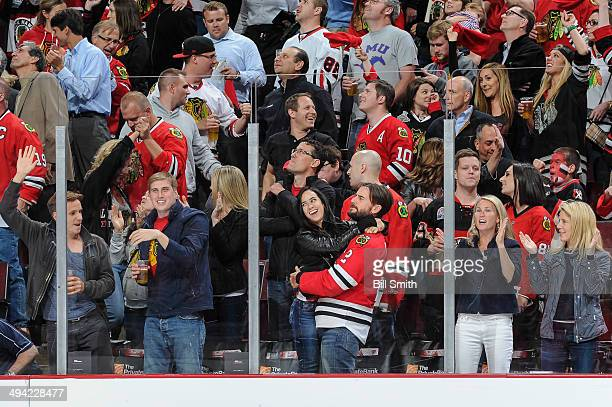 Engaged WWE wrestlers AJ Lee and CM Punk celebrate after the Chicago Blackhawks scored against the Los Angeles Kings in Game Five of the Western...