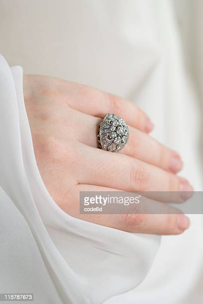 Engagement ring on bride's finger, her POV, copy space