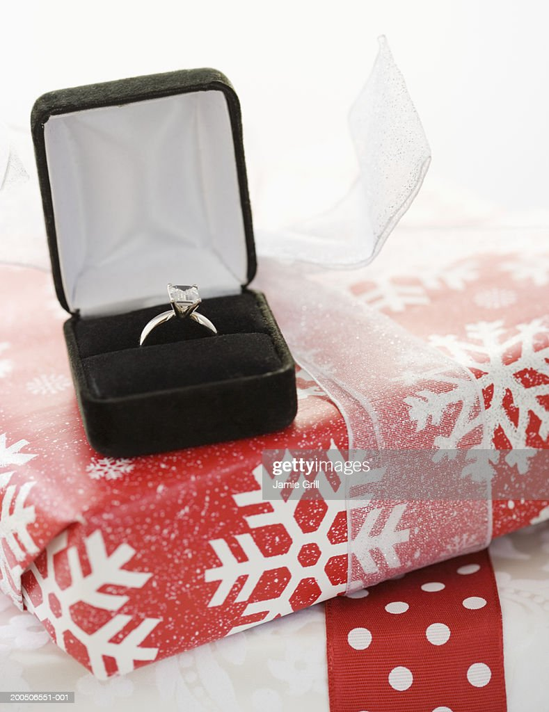 Engagement ring on christmas present : Stock Photo