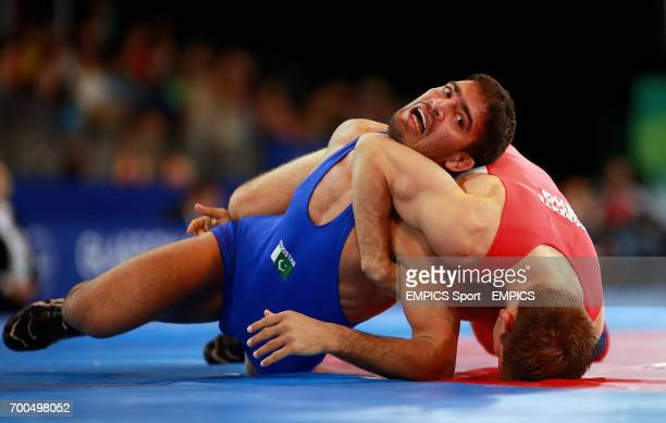 Engalnd's Philip Roberts takes on Pakistan's Muhammad Salman during the Men's Wrestling at the SECC during the 2014 Commonwealth Games in Glasgow