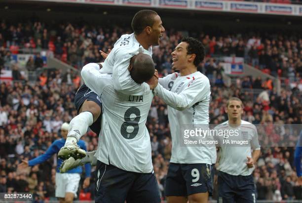 Engalnd's Wayne Routledge celebrates scoring his side's second goal of the game with team mate Leroy Lita and Kieran Richardson