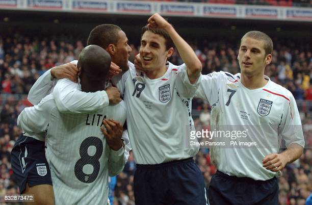 Engalnd's Wayne Routledge celebrates scoring his side's second goal of the game with team mate Leroy Lita Matt Derbyshire and David Bentley