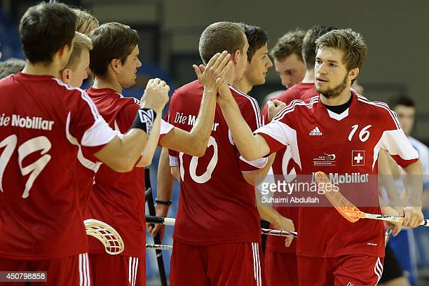 Engel Manuel of Switzerland celebrates with teammates after scoring a goal during the World University Championship Floorball match between...