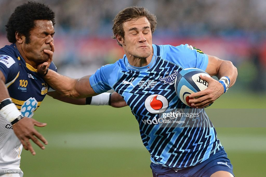 JJ Engelbrecht of the Bulls hands off Henry Speight (L) of the Brumbies during the SupeRugby semi final match between Vodacom Bulls and Brumbies from Loftus Versfeld Stadium on July 27, 2013 in Pretoria, South Africa.