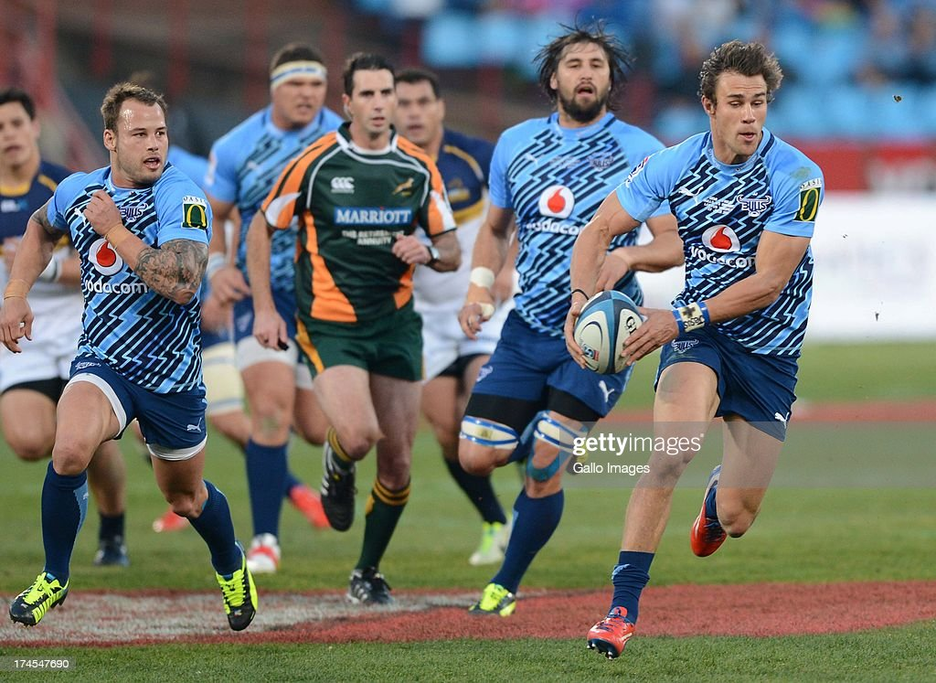 JJ Engelbrecht of the Bulls runs with the ball during the SupeRugby semi final match between Vodacom Bulls and Brumbies from Loftus Versfeld Stadium on July 27, 2013 in Pretoria, South Africa.