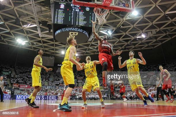 Engin Atstuer of Berlin Bogdan Radosavljevic of Berlin und Devin Booker of Munich battle for the ball during the easyCredit BBL Basketball Bundesliga...