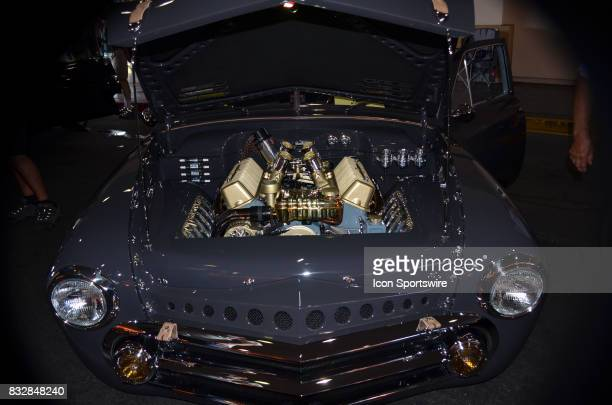 Engine compartment sparkles on the 1951 Ford is fully chromed and matched with the exterior paint job at the Hot August Nights Custom Car Show the...