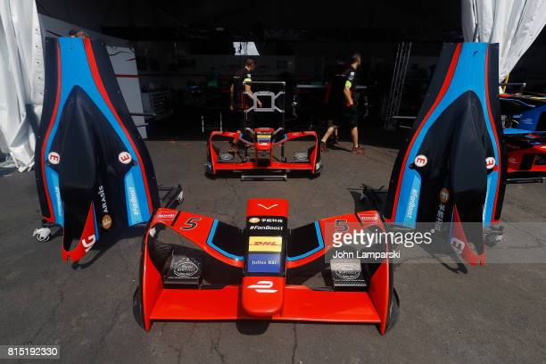 Engine covers and front spoilers are seen in the pits during the Formula E Qualcomm New York City ePrix on July 15 2017 in New York City