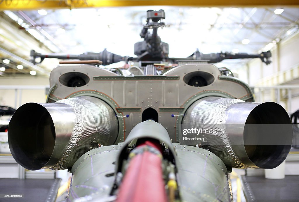 Engine exhaust pipes exit the rear chassis of a Super Lynx 300 helicopter, produced by AgustaWestland, a unit of Finmeccanica SpA, during assembly at the company's plant in Yeovil, U.K., on Thursday, June 12, 2014. U.K. unemployment declined more than expected and industrial production rose at the fastest annual pace since 2011, according to reports released this week. Photographer: Chris Ratcliffe/Bloomberg via Getty Images