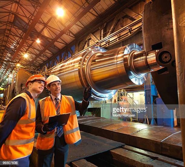 Engineer & Apprentice With Steel Roller