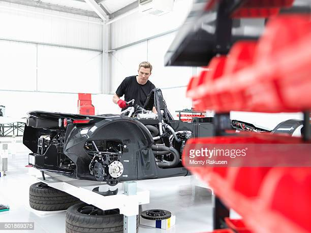 Engineer assembling supercar in sports car factory