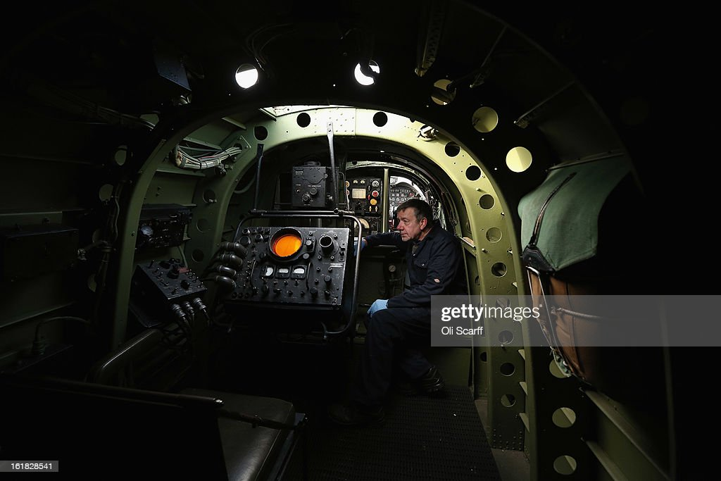 Engineer Bob Mitchell inspects the Lancaster bomber 'Just Jane' , with the aim of getting it airworthy, at Lincolnshire Aviation Heritage Centre on February 14, 2013 in East Kirkby, England. The plane, which last flew in 1971, would become one of only three airworthy Lancaster bombers in the world. Brothers Fred and Harold Panton, owners of the Lincolnshire Aviation Heritage Centre, are restoring the plane in memory of their sibling, Christopher Panton, who died aged 19 when his Lancaster was shot down in 1944.