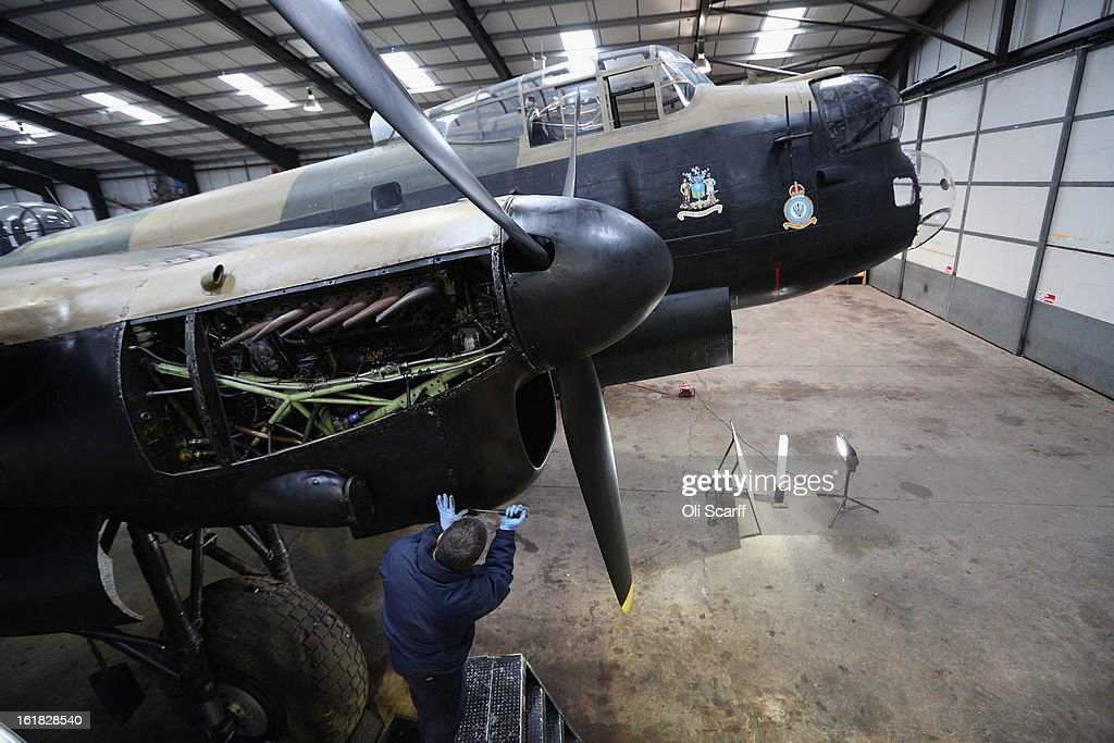 Engineer Bob Mitchell works on the Lancaster bomber 'Just Jane' , with the aim of getting it airworthy, at Lincolnshire Aviation Heritage Centre on February 14, 2013 in East Kirkby, England. The plane, which last flew in 1971, would become one of only three airworthy Lancaster bombers in the world. Brothers Fred and Harold Panton, owners of the Lincolnshire Aviation Heritage Centre, are restoring the plane in memory of their sibling, Christopher Panton, who died aged 19 when his Lancaster was shot down in 1944.