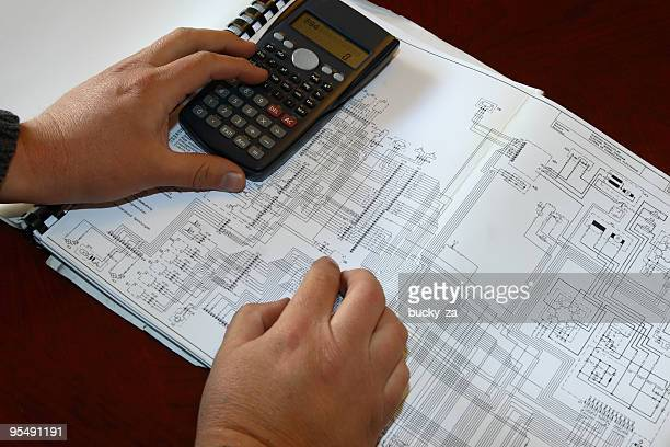 Engineer calculating on diagram
