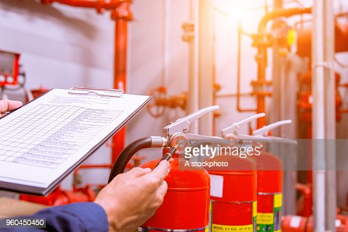 Engineer checking Industrial fire control system,Fire Alarm controller, Fire notifier, Anti fire.System ready In the event of a fire. : Stock Photo