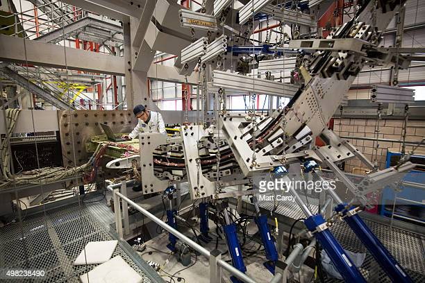 A engineer conducts a fatigue test on a Airbus A380 sharklet wing tip on a test rig at the Airbus aircraft manufacturer's Filton site on November 19...