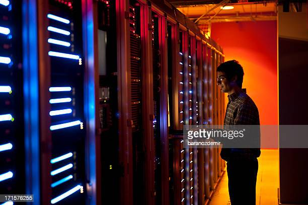 IT engineer configuring servers in data center