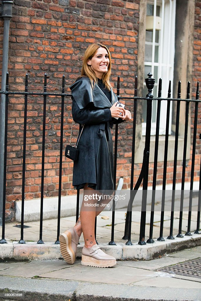 Engineer Dimitra Koutsi wears thing black leather Milla jacket light pink Stella McCartney platform shoes and a small Moschino chain leather purse...
