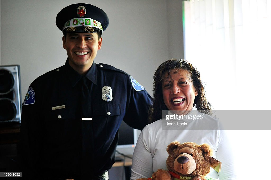 Engineer Eliasar Maldonado delivers holiday gifts to an underpriviledged family for the 12th Annual CMFD Santa Letters on December 22, 2012 in Costa Mesa, California.