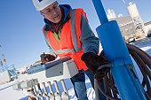 Engineer examining pneumatic hoses at industrial facility