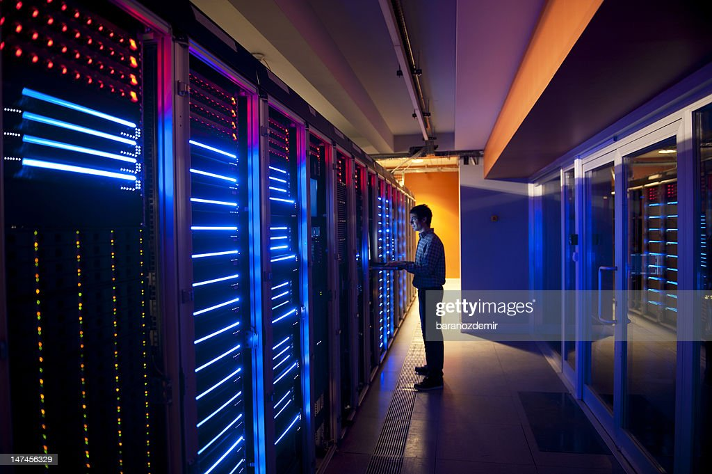 IT Engineer in Action Configuring Servers : Stock Photo