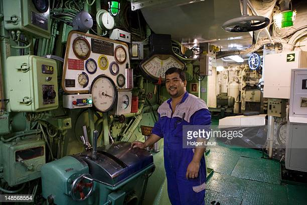 Engineer in engine room of cruiseship MV Princess Daphne (International Classic Cruises) during North Sea voyage.