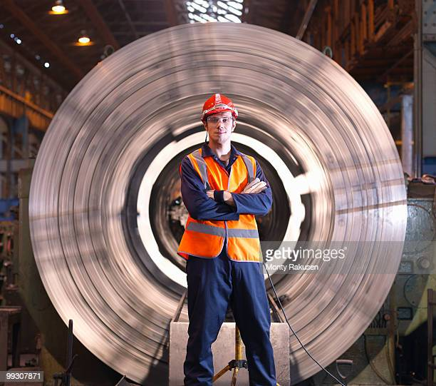 Engineer In Front Of Steel Lathe