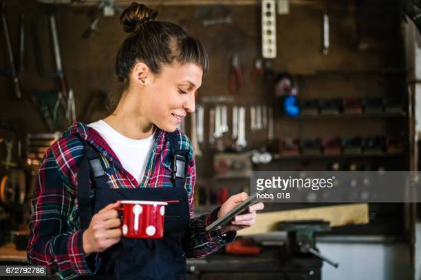 Engineer in workshop coffee break