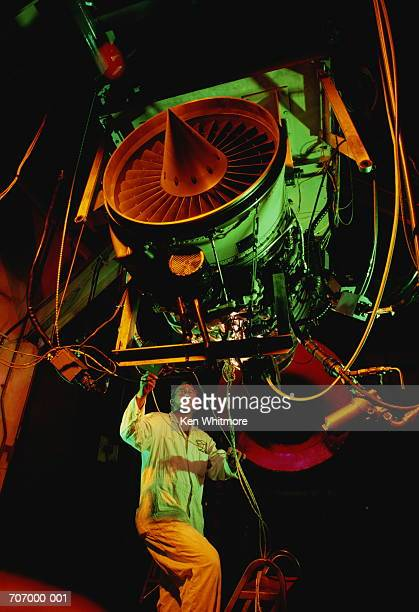 Engineer inspecting aircraft engine