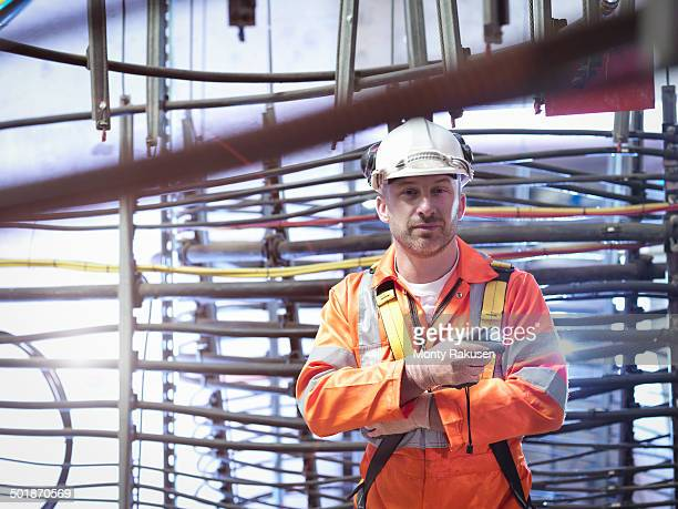 Engineer inspecting cable expansion in suspension bridge, portrait. The Humber Bridge, UK, built in 1981 was the world's largest single-span suspension bridge