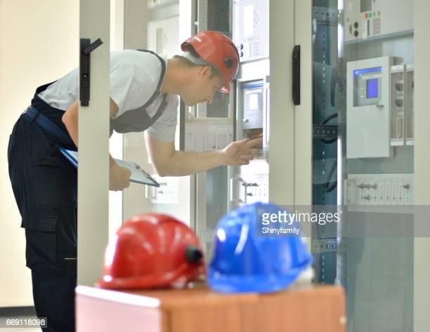 Engineer inspecting functionality of equipment