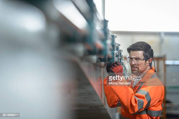 Engineer inspecting marine fabrication used for cable laying, close up