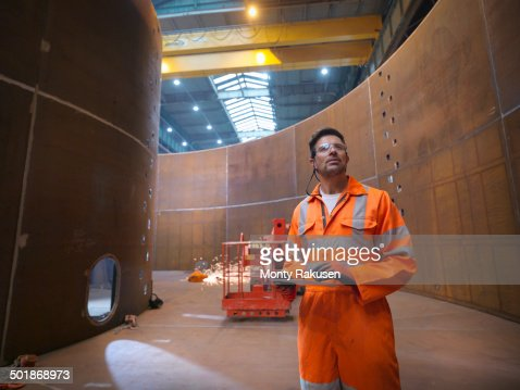 Engineer inspecting marine fabrication used for cable laying