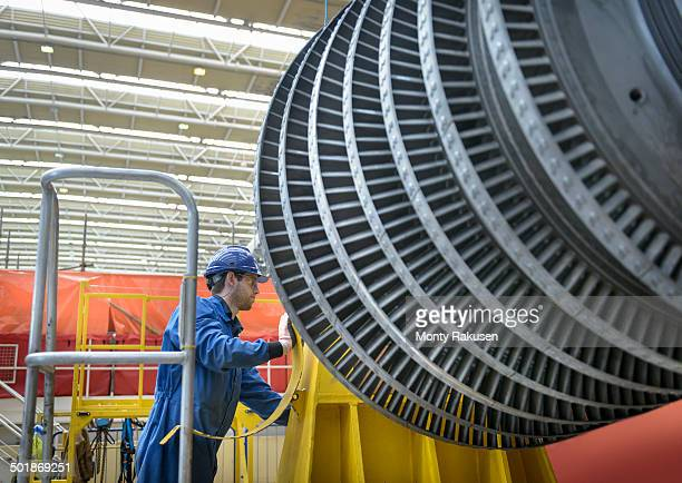Engineer inspecting turbine during power station outage