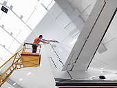 Engineer inspects jet aircraft