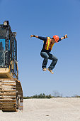 Engineer jumping out from an earth mover